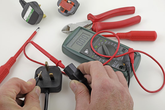 Voltage checking of a portable appliance